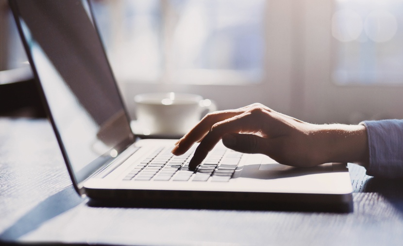 hand-typing-on-laptop