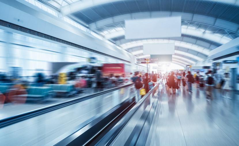 walking-escalator-in-airport-blurred