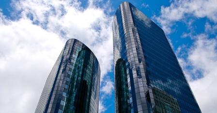 two-modern-buildings-sky