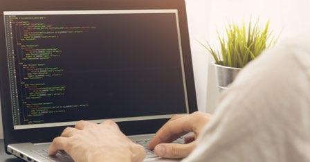 back-office-man-coding-at-laptop