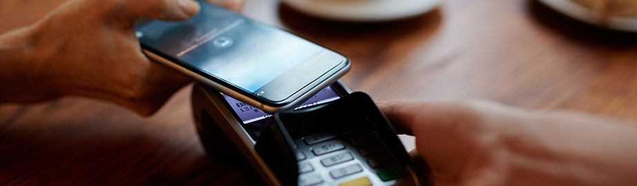 Customer using mobile payment at cafe