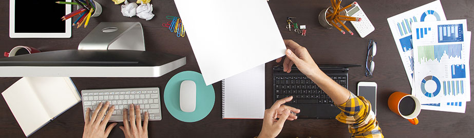 Professionals working together at large desk