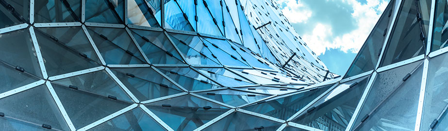 Architectural detail of glass and steel panels on modern building