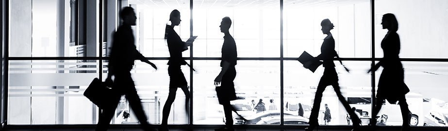 Silhouettes of business women walking in office