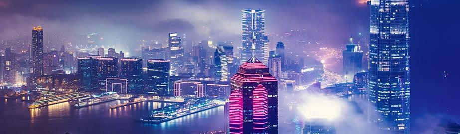 Hong Kong urban scene at night in misty fog