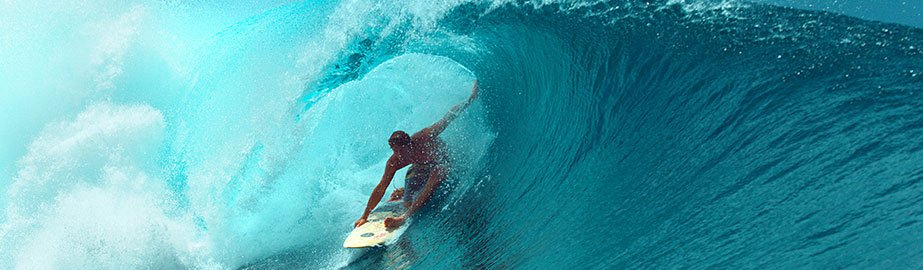Close up of surfer riding wave
