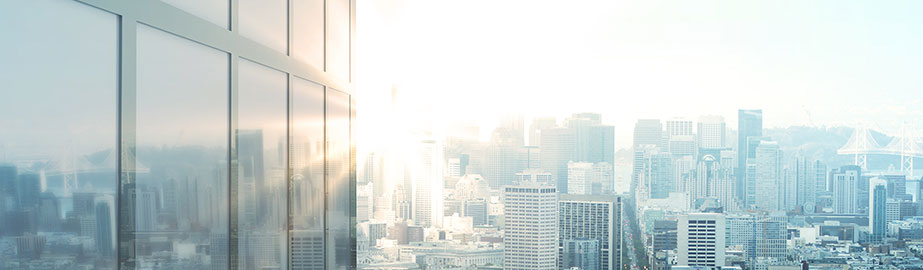 City skyline and modern building with reflected bright sunlight